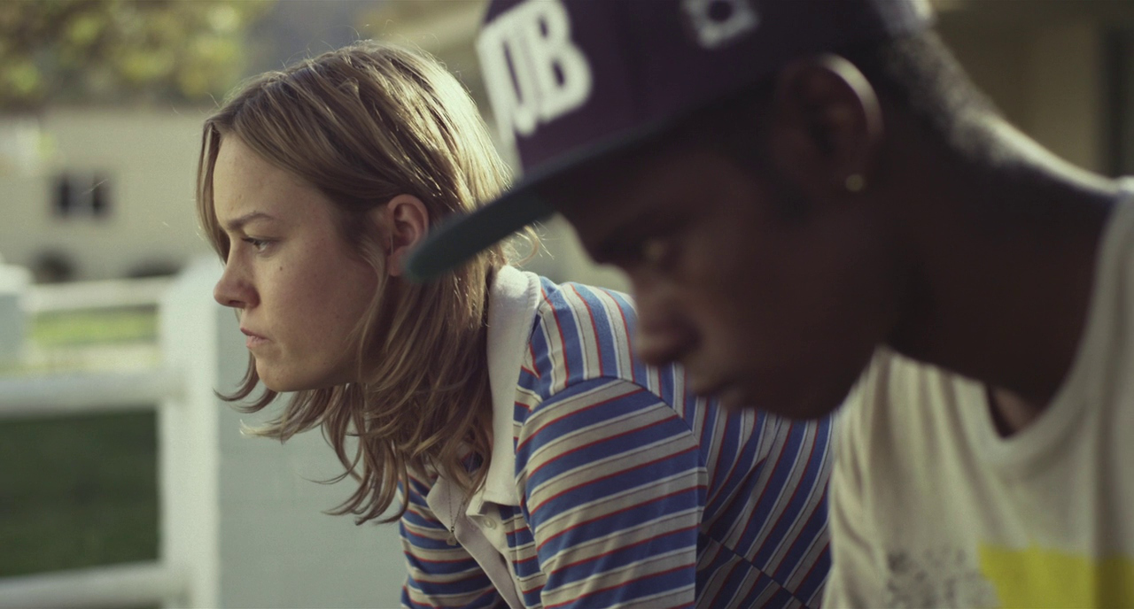 An Image from Short Term 12 (2013), a blonde woman - Grace - looks out into the distance whilst sat with teenager Marcus