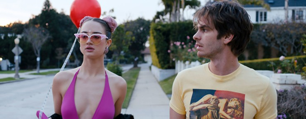two characters from Under The Silver Lake walking down the streets