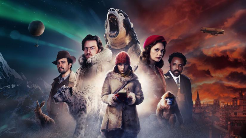 A young girl from His Dark Materials poses in front of a roaring polar bear and four other people.