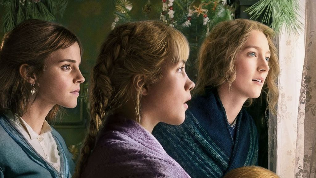 Three women in the late 1800's looking out of a window, from the film Little Women.