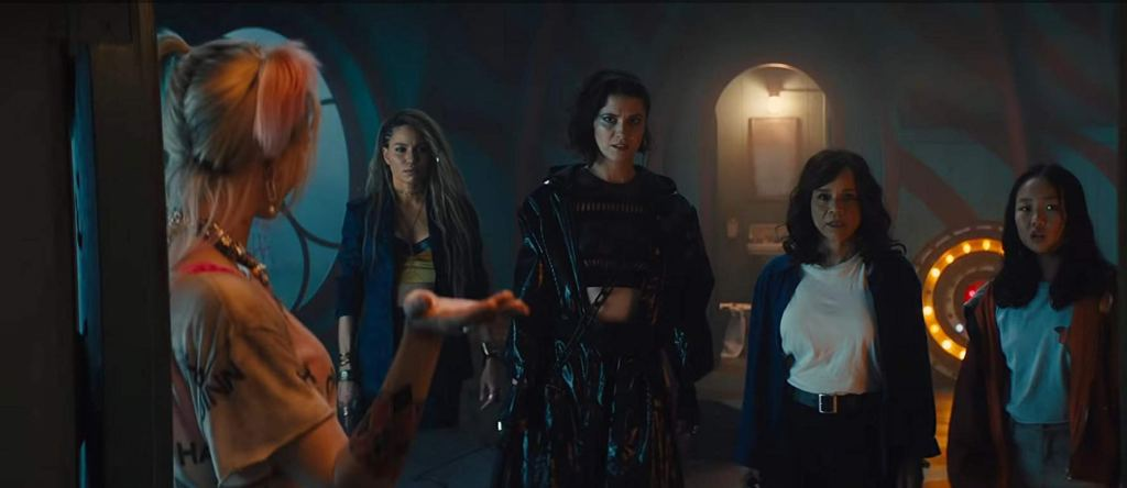 the formed girl gang looking at Harley Quinn for direction