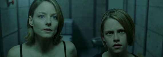 This image is from Panic Room. Jodie Foster is on the left, and a young Kristen Stewart is on the right. They are both looking the camera's direction.