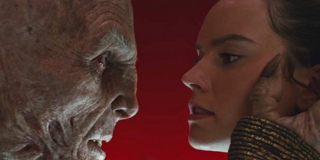 A humanoid alien grabbing the face of a young woman, from the film Star Wars: The Last Jedi.