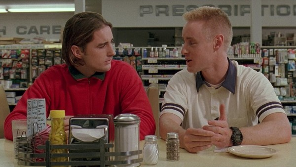 Screencapture from Bottle Rocket. Two men sit in a diner waiting to be served.