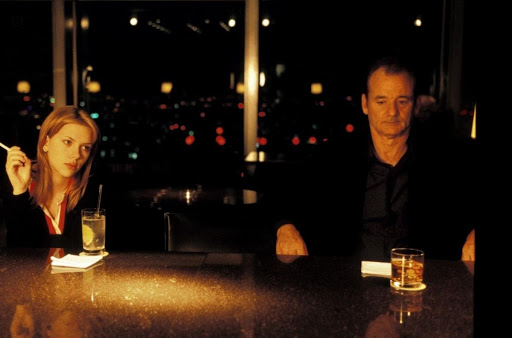 Screencapture from Lost in Translation. A man and a woman sit at a bar together.
