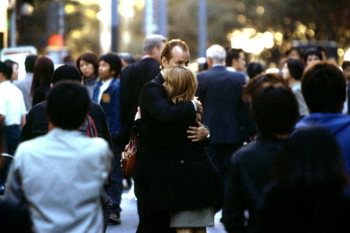 Screencapture from Lost in Translation. A man and woman embrace in a busy street.