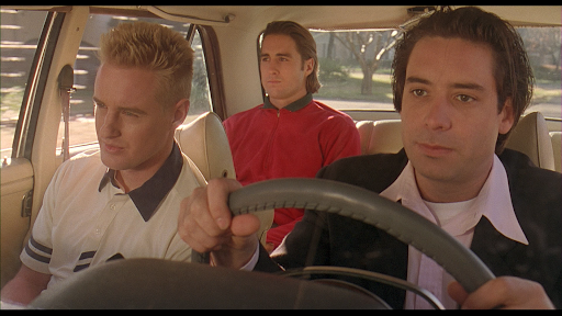 Screencapture from Bottle Rocket. Three men sit in a car.