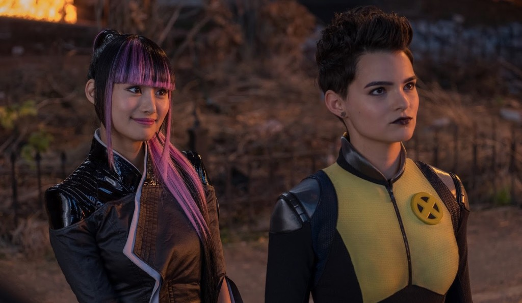 Negasonic Teenage Warhead stands on the right of the image, dressed in the black and yellow X-Men uniform. Yukio stands to her left, dressed in black and with pink highlights in her hair.