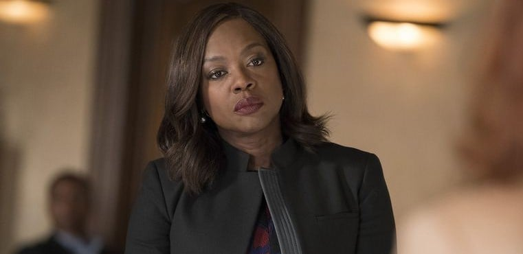 Annalise looks formidable wearing a black coat and a hardened expression.