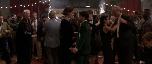 Screencapture from Rushmore. A woman and a teenage man dance at a busy party.