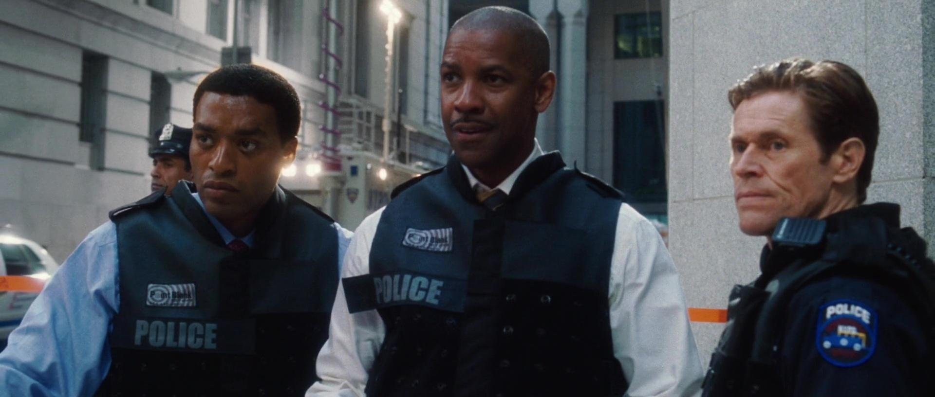 Inside Man. Left to right - Chiwetel Ejiofor, Denzel Washington and Willem Dafoe, all in police uniform.