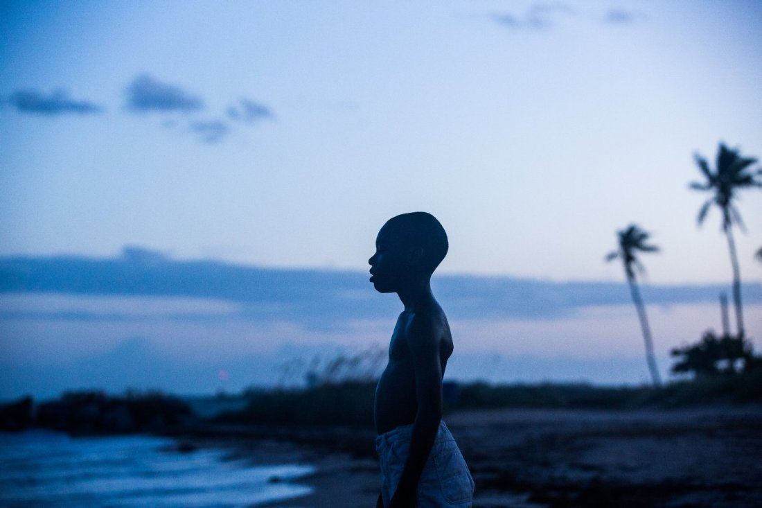 This image is from the film Moonlight. A child is silhouetted by a beach at night.