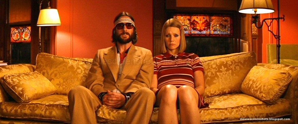 Screencapture from The Royal Tenenbaums. A man and a woman sit on a sofa.