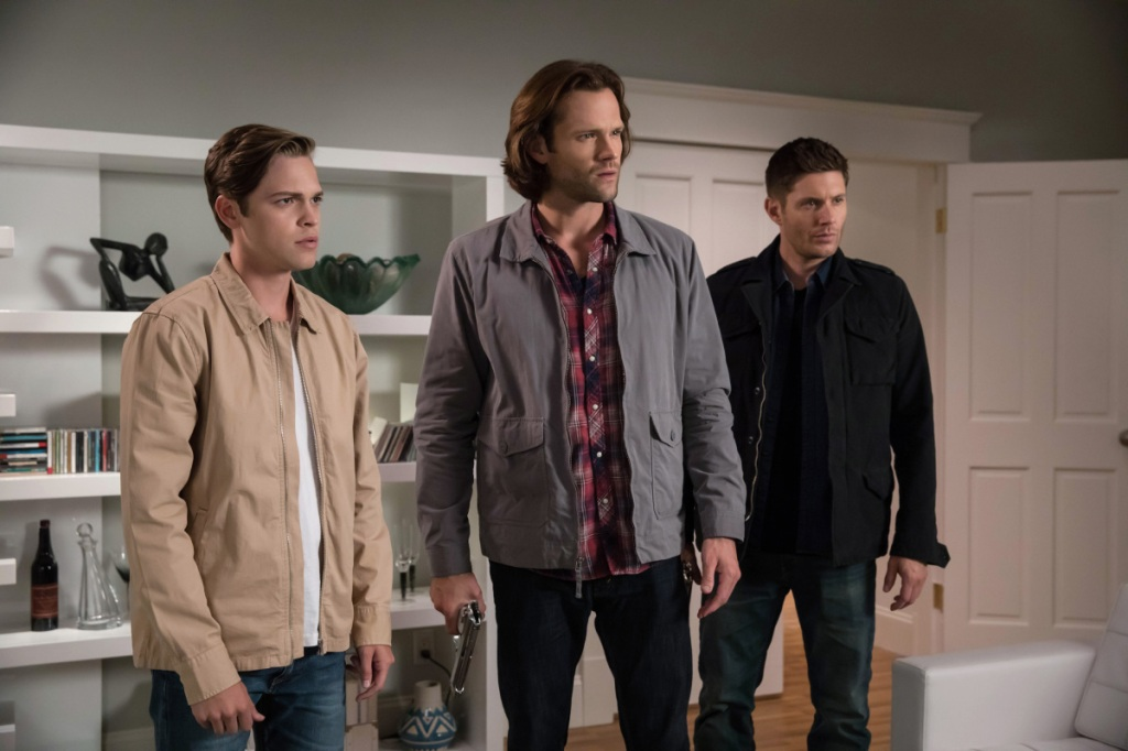 Image of Jack, Sam Winchester and Dean Winchester standing next to each other in a room.