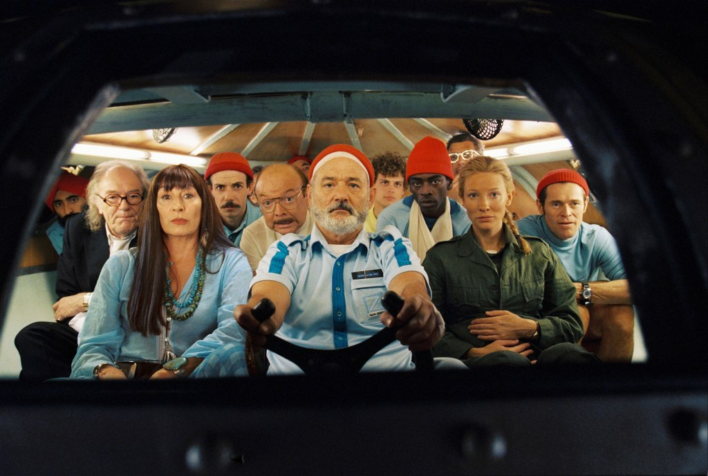 Screen capture from The Life Aquatic with Steve Zissou. The cast of The Life Aquatic with Steve Zissou viewed through the window of a submarine.