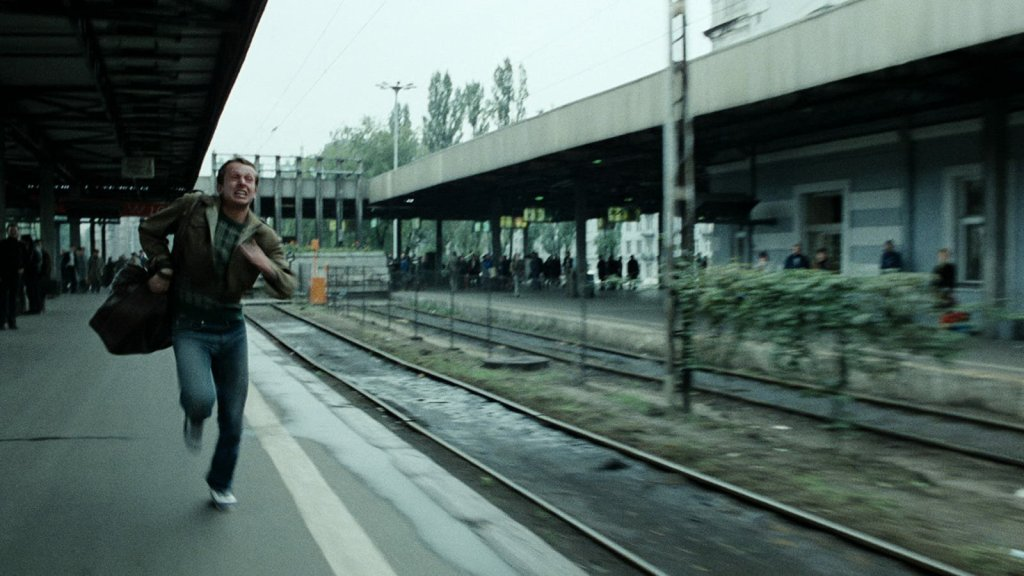 The protagonist of Blind Chance runs desperately towards a departing train