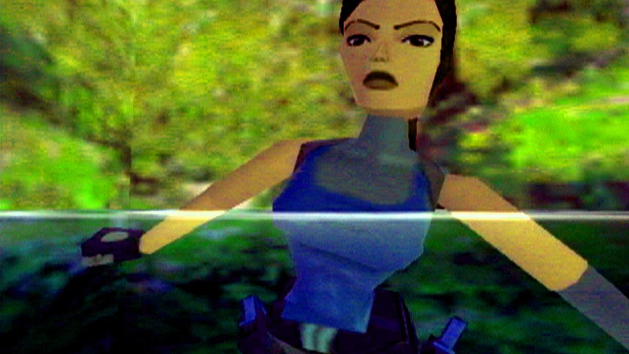 Image shows Lara Croft from the game Tomb Raider submerged in water.