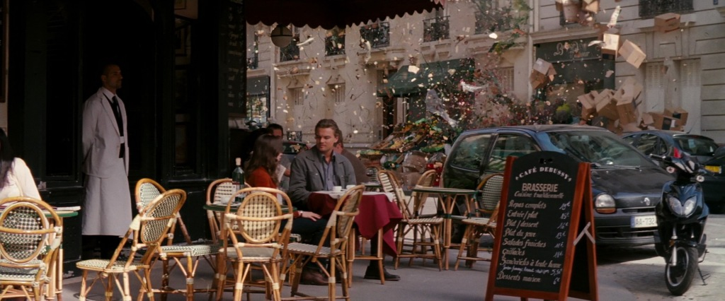 Signature shot from Inception, where Ellen Page playing Ariadne and Dom are dreaming, sitting at a cafe terrace, when everything around them starts blowing apart