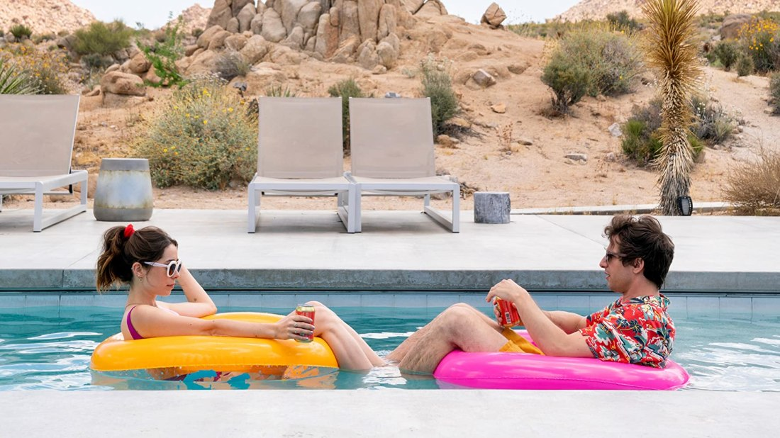 Picture of Sarah and Nyles sitting in yellow and pink pool floaties. Left is Cristin Milioti and to the right is Andy Samberg.