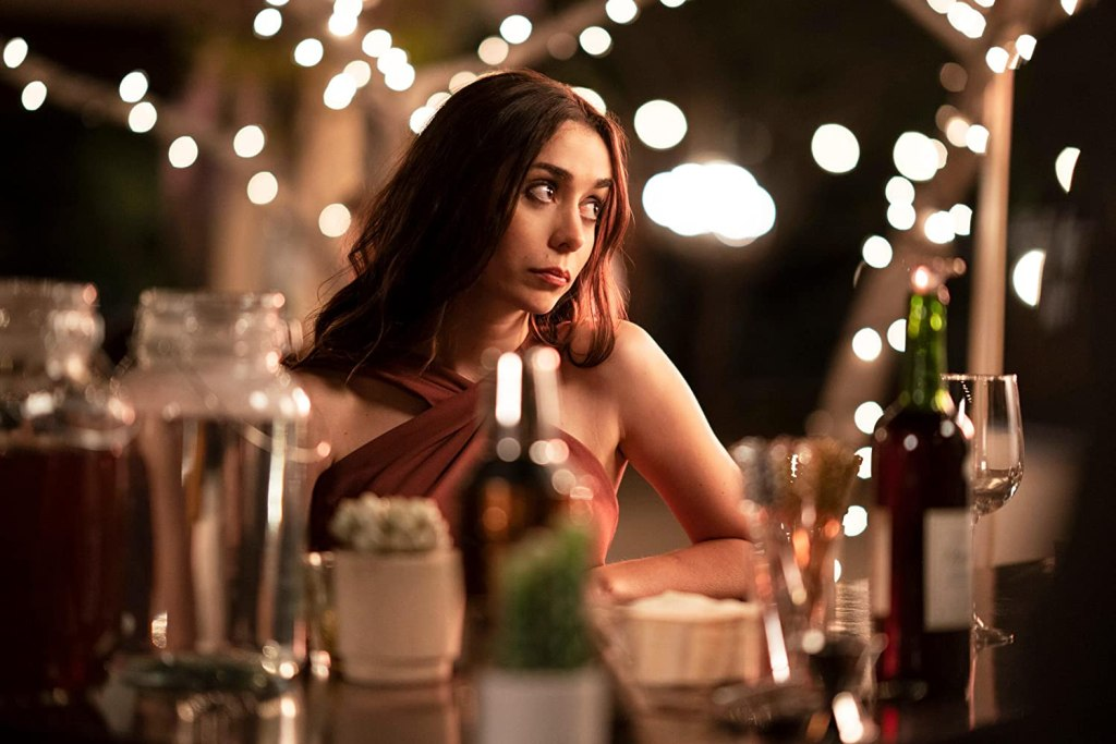 Picture of Cristin Milioti as Sarah sitting at a table.