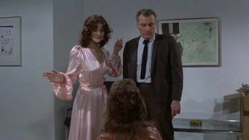 Movie still from the film Sisters (1973)- Margot Kidder, Jennifer Salt, and Dolph Sweet are shown in a scene talking