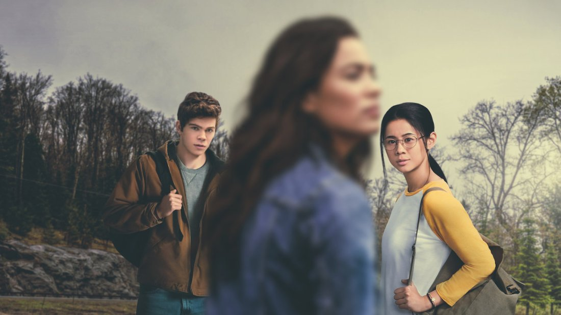 The poster for The Half of It. Paul (left) and Ellie (right) stare at the blurred out figure of Aster who is directly in front of them.
