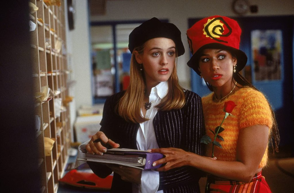 Cher and Dionne standing near the teacher mailboxes at school, carrying out their plan to make a romantic match between two teachers.
