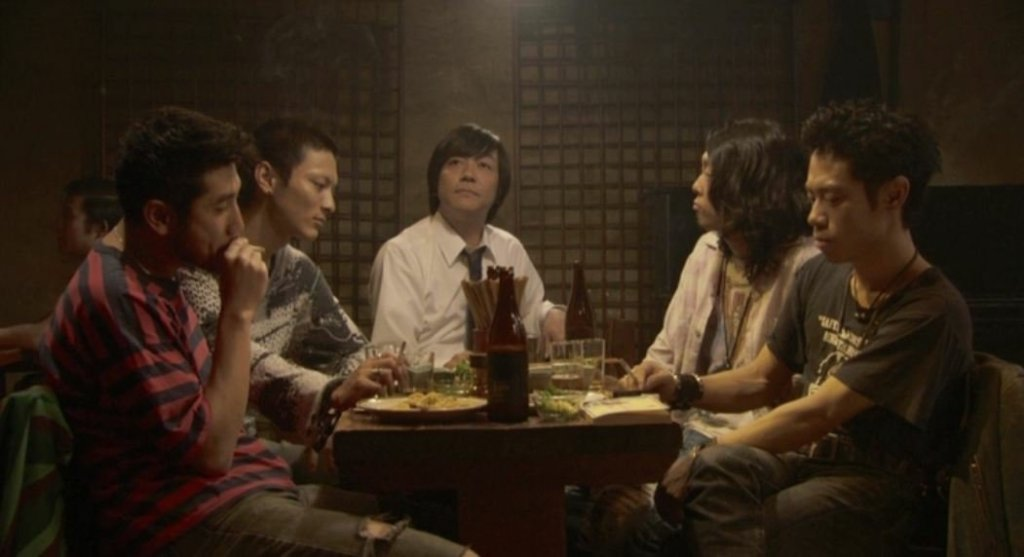 The band and manager behind the song 'Fish Story' sit reflecting, in various states, on their performance