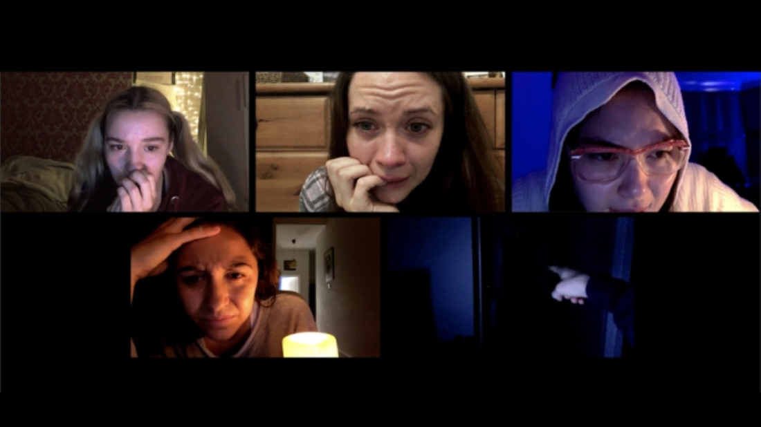 Image still from the horror film Host. On a Zoom call, four women look scared and in distress.