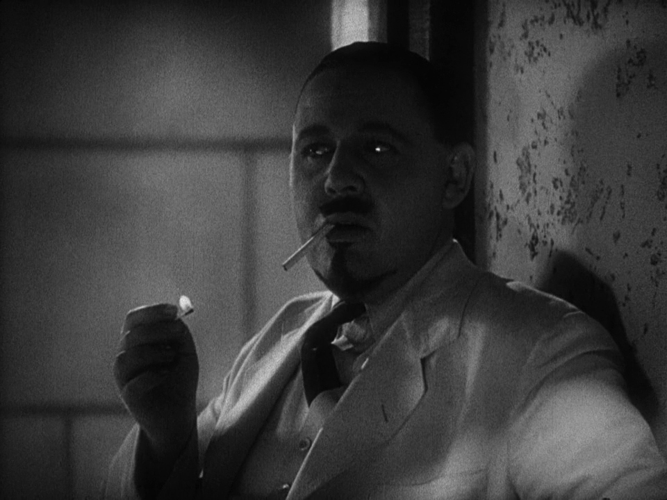 Dr. Moreau (Charles Laughton) smoking a cigarette in Island of Lost Souls.