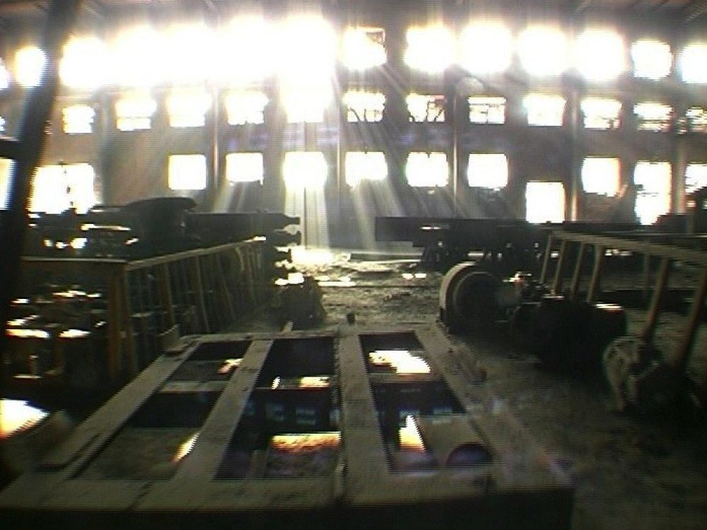 Image of light pouring into a derelict factory.