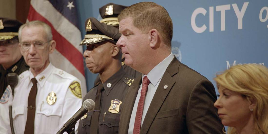 Image shows Mayor Marty Walsh delivering a press conference.