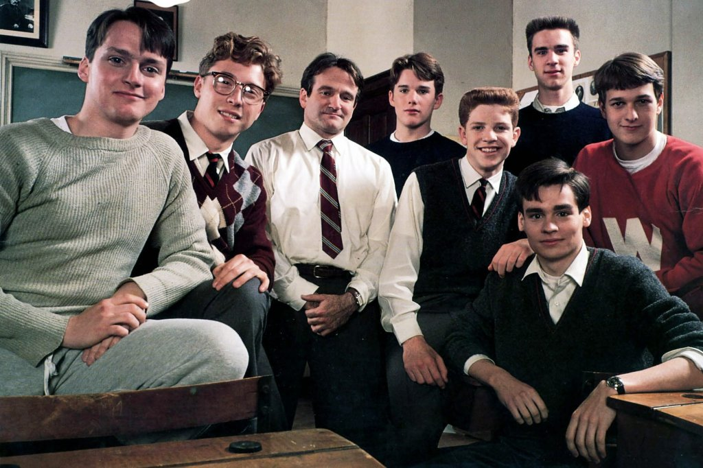 The main cast of Dead Poets' Society pose enthusiastically for an in-character promotional photo