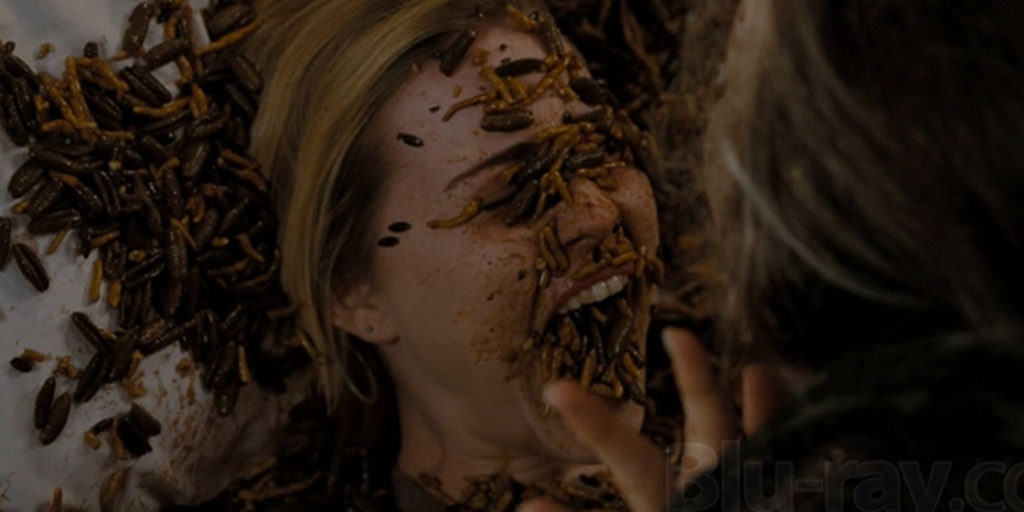 Movie still from Drag Me To Hell (2009)- Christine (Alison Lohman) has maggots all over her face and bed and inside her mouth.