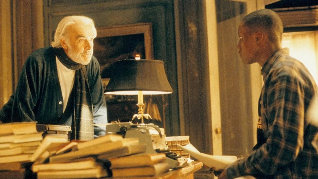 Forrester and Jamal, of Finding Forrester, have a serious but amiable discussion over a stack of books in the former's softly lit home