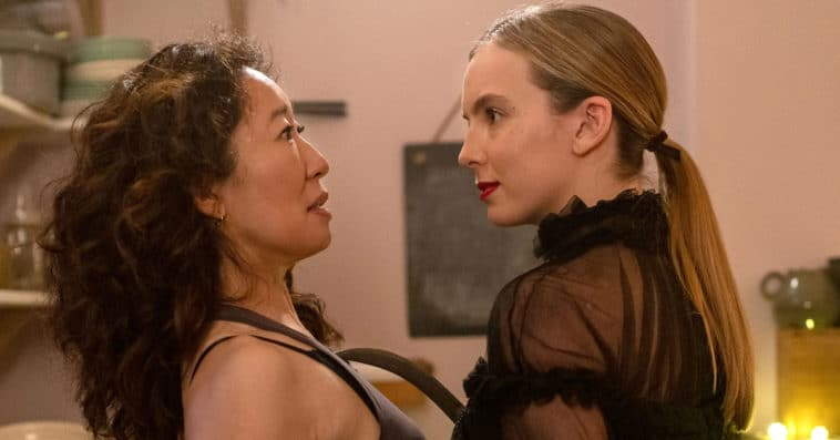 Villanelle and Eve gaze at one another in the kitchen.