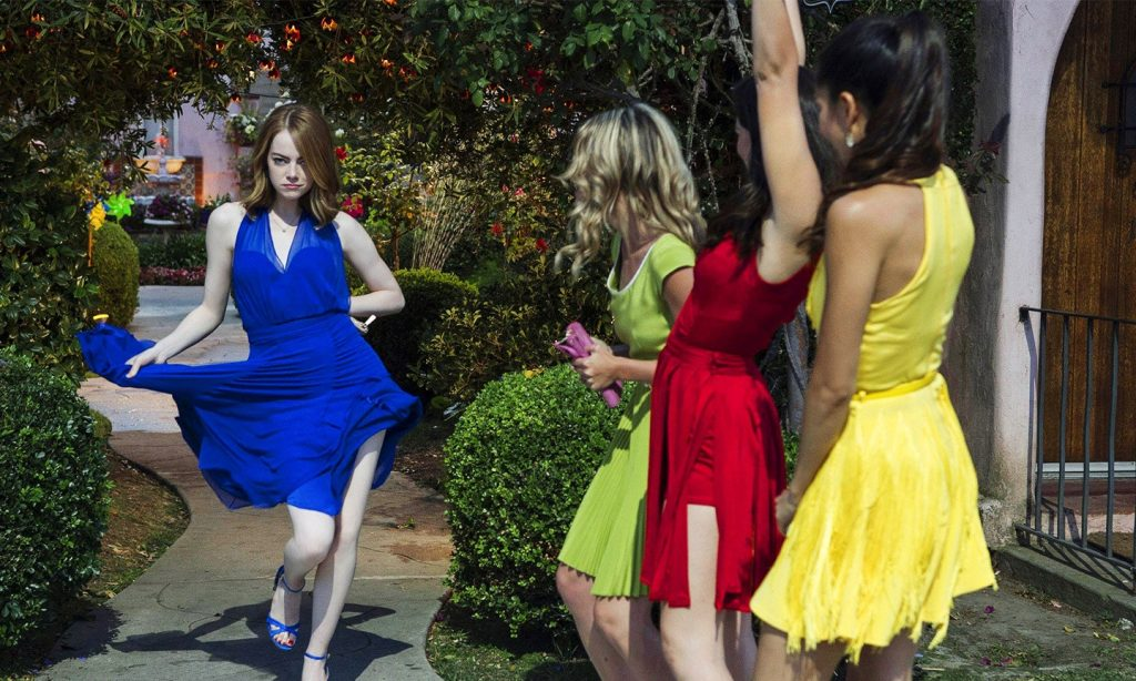 This image is from La La Land. Mia, dressed in an elegant blue dress, dances with her friends