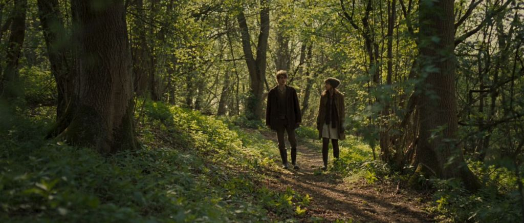 Tommy (Andrew Garfield) and Kathy (Carey Mulligan) converse as they walk through the woods. From 'Never Let Me Go'.