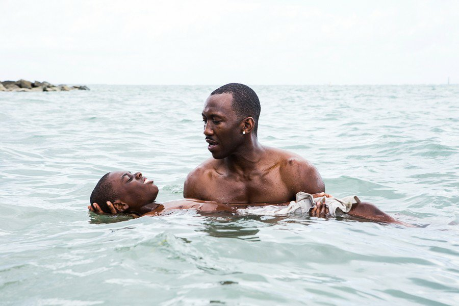 Juan holds Chiron afloat in the sea in an early scene from Moonlight