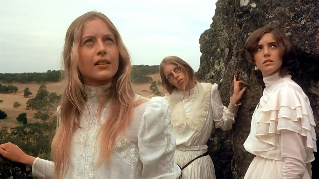 Left to right, Miranda (Anne-Louise Lambert), Marion (Jane Vallis), and Irma (Karen Robson) ascend Hanging Rock.