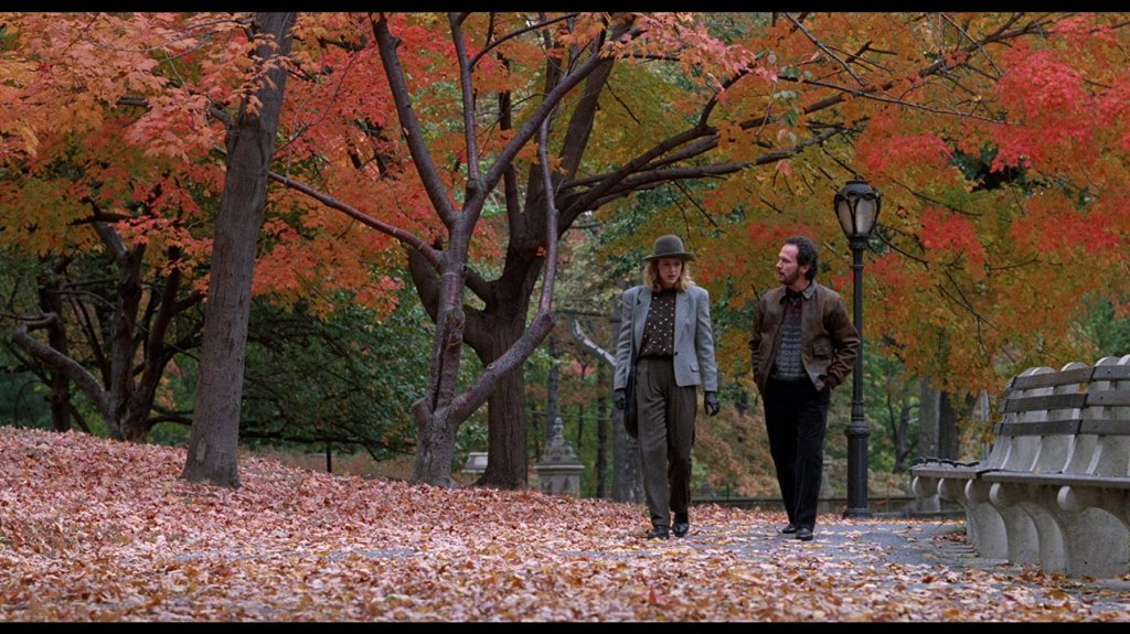Harry and Sally talk while walking through Central Park in the fall.