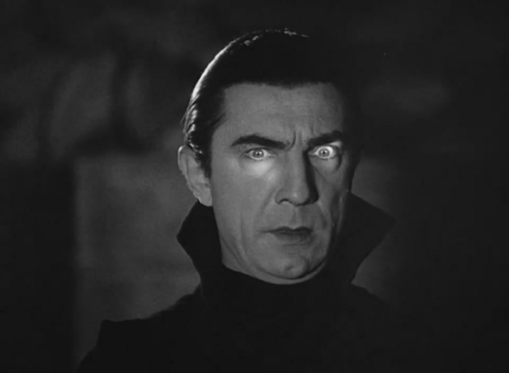 Dracula stares in the shadows.