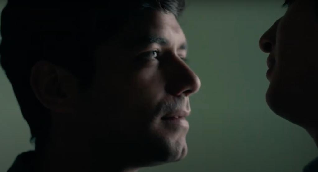 Closeup of Gerardo, staring at Iván's lips.
