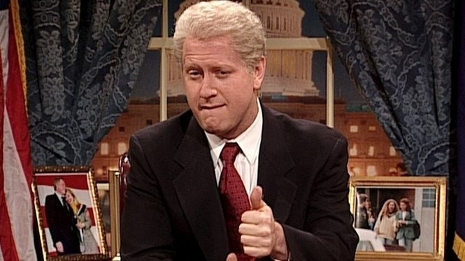 Darrell Hammond bites his lip and sticks up a thumb in his portrayal of then-president Bill Clinton on SNL