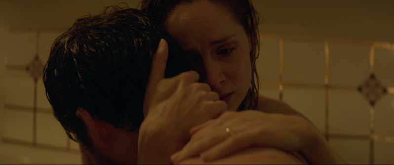 Image is from the film Rose: A Love Story. A couple hug one another in a bathroom.