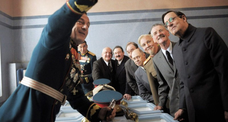 Image is from the film The Death of Stalin. A group of politicians crowd round to take a photo.