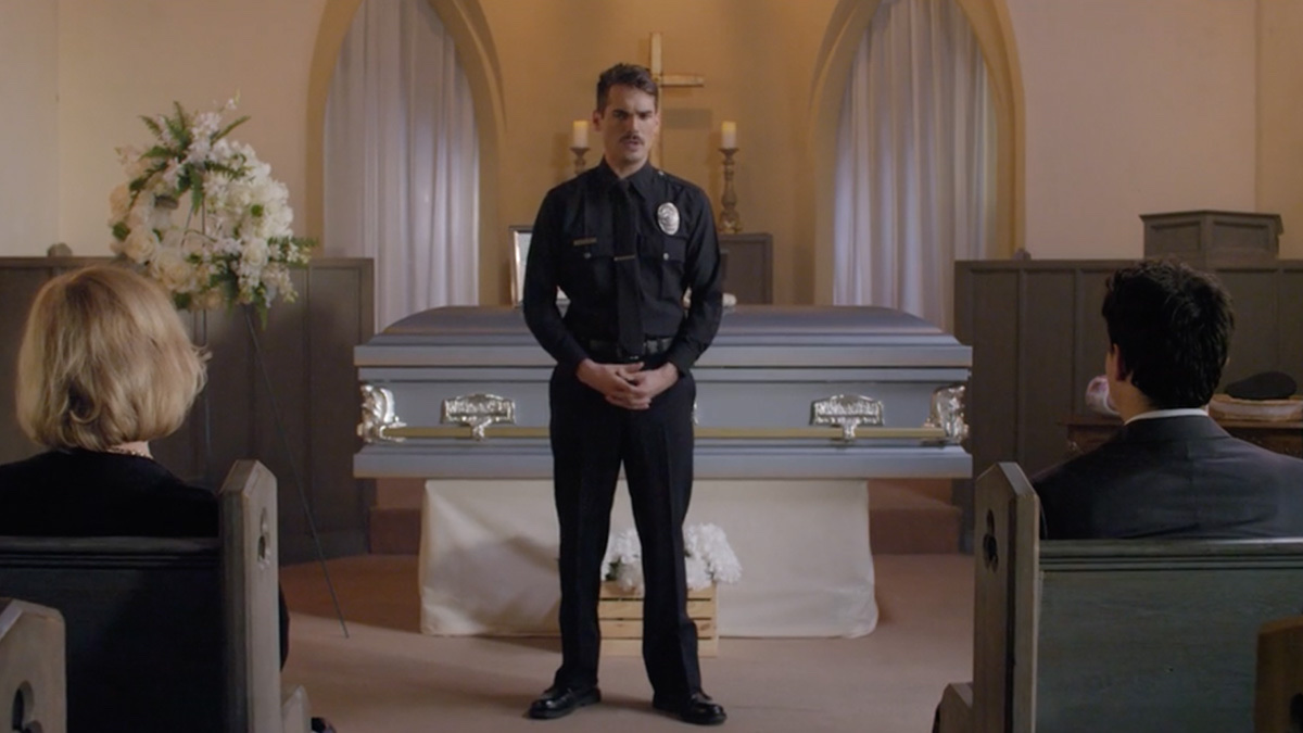 Jim Cummings ' Officer Jim Arnaud stands shakily at his mother's funeral