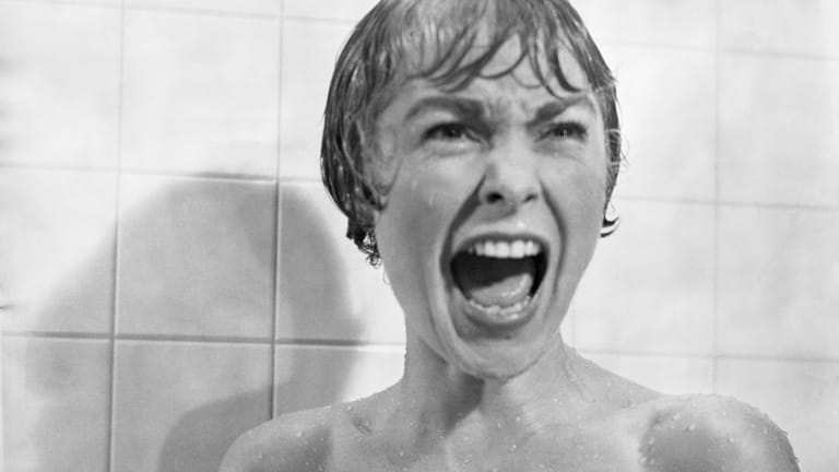 Black and white movie still of Janet Leigh as Marion Crane in Psycho.