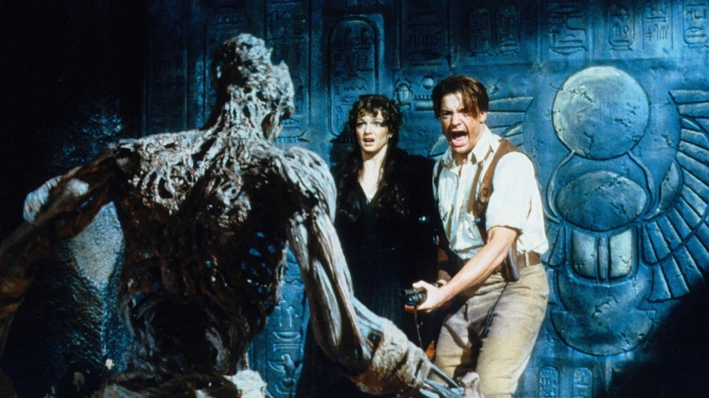 Rick and Evelyn scream and back up against a wall as the rotten carcus of the mummy approaches them.