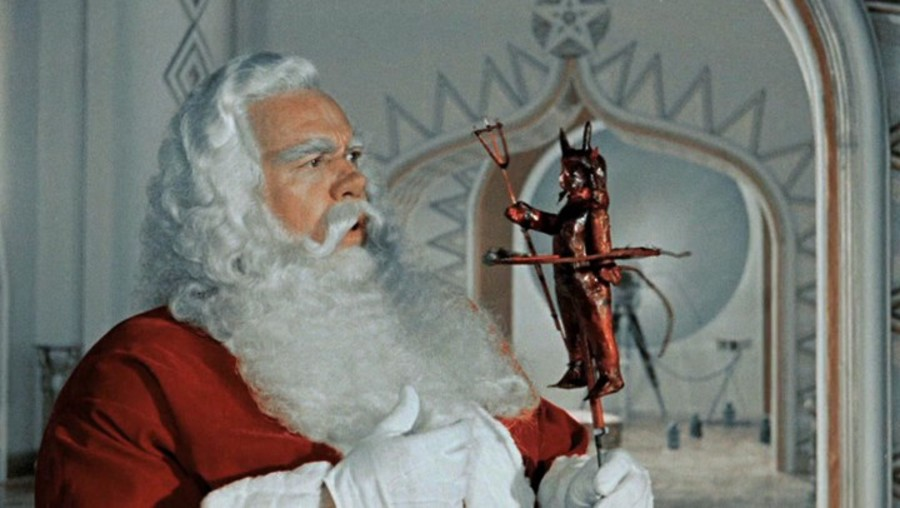 Santa holds a puppet figure of Pitch, the devil.